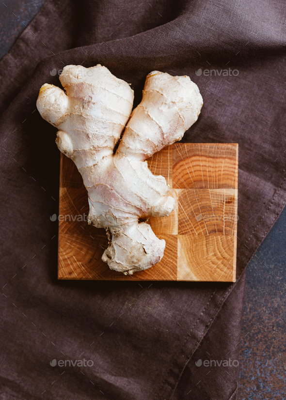 Top view of a ginger root on a wooden board. - Stock Photo - Images