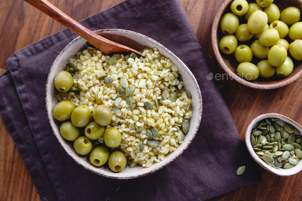 Bulgur with green olives and pepitas - Stock Photo - Images