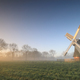 Dutch windmill in misty sunrise - PhotoDune Item for Sale