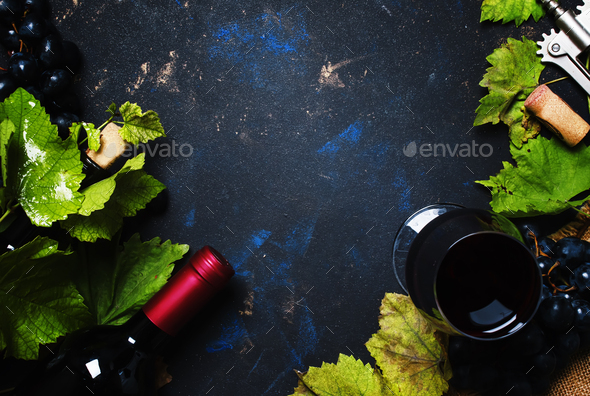 Red wine with grape, black background, top view - Stock Photo - Images
