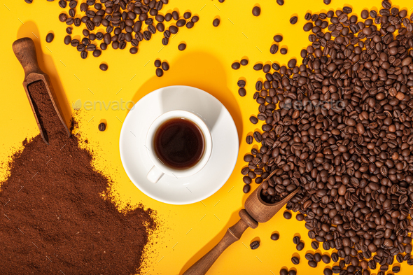 Coffee cup and roasted beans on yellow background - Stock Photo - Images