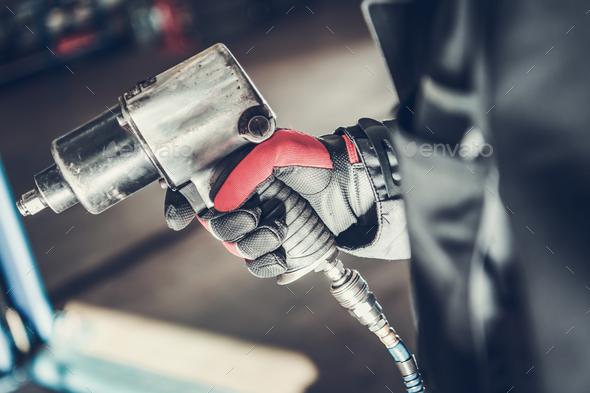 Mechanic Holding Pneumatic Wrench Gun. - Stock Photo - Images