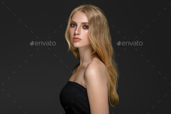 Long blonde hair model woman over black background film effect. Beauty concept. - Stock Photo - Images