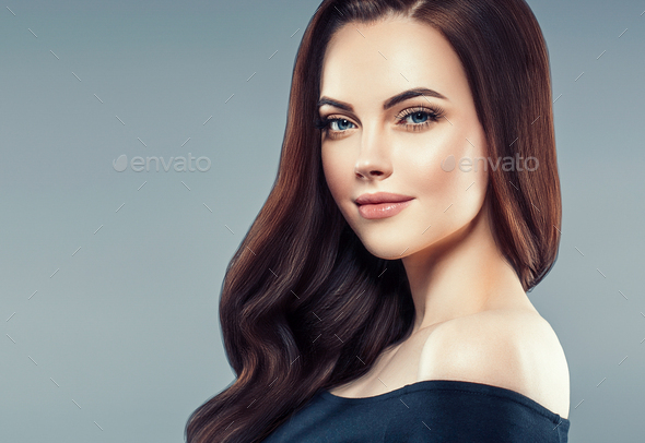 Brunette curly hair. Beautiful woman with long beauty healthy hair portrait - Stock Photo - Images