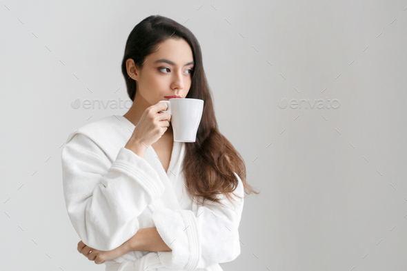 Beautiful woman with cup in hands at home, drink tea or coffe - Stock Photo - Images