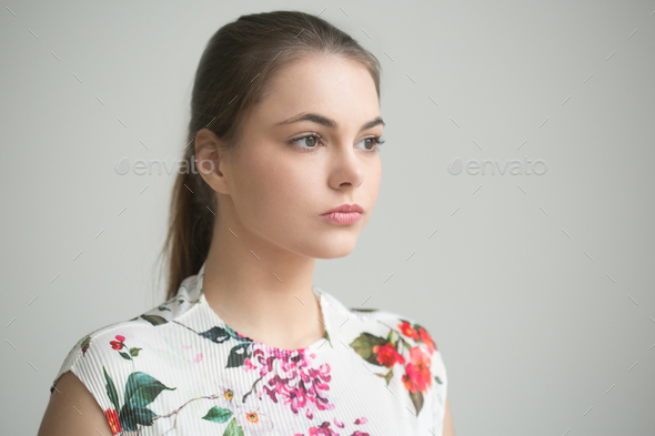 Beautiful girl natural portrait. Young female over gray wall - Stock Photo - Images