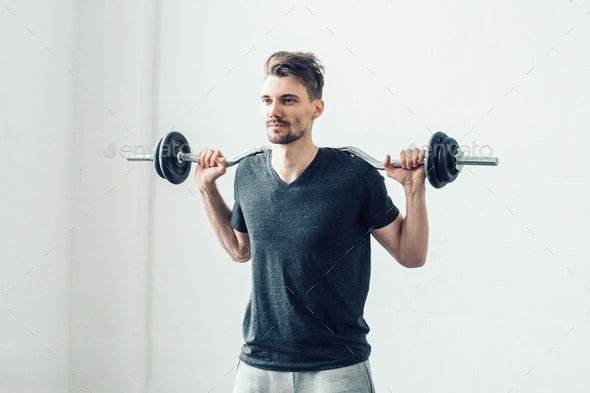 Man in gym. Sport handsome guy on sporty training - Stock Photo - Images