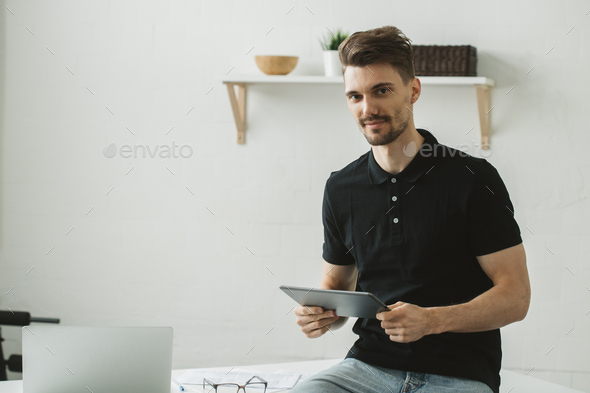 Man with tablet indoors portrait. Male portrait with tablet home - Stock Photo - Images