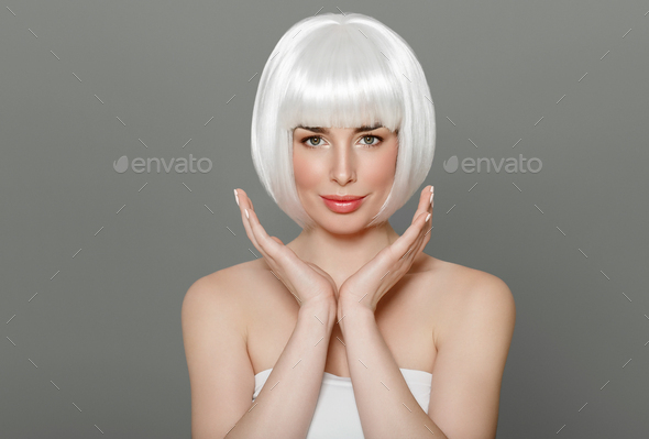 Short blonde hair woman bob platinum hairstyle over gray background - Stock Photo - Images