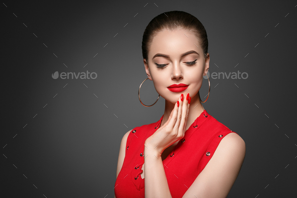 Beautiful curle hair female in red with red lips and dress manicure, beauty red afro hairstyle - Stock Photo - Images