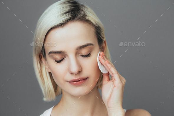 Woman with cotton pad face blonde hair closeup female portrait - Stock Photo - Images