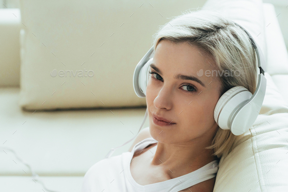 Woman in headphones at home listening to music, relax alone close up portrait. - Stock Photo - Images