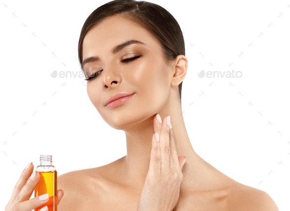 Woman with oil cosmetic beauty skin care concept. Young female model spa with oil skincare - Stock Photo - Images