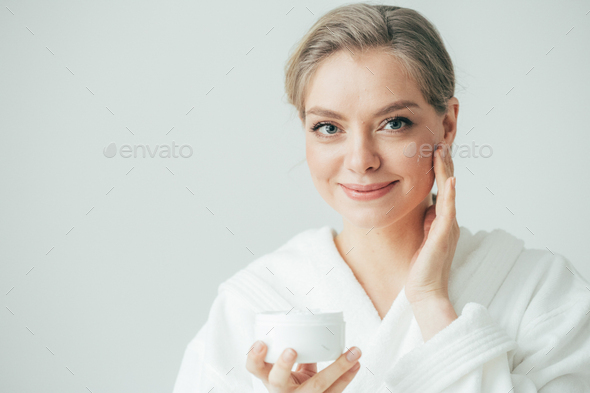 Woman face cream, happy young female cosmetic beauty, pure and fresh healthy skin - Stock Photo - Images