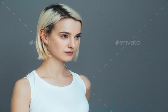 Beautiful young woman portrait, with blonde short highlights hair portrait. Pretty female. - Stock Photo - Images