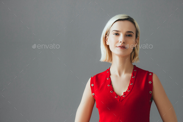 Nice woman in red dress blonde short hair. Fashion female portrait cute nice girl - Stock Photo - Images