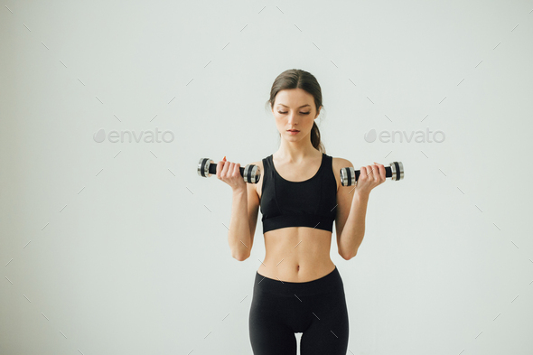 Young beautiful sporty woman home doing sports training - Stock Photo - Images
