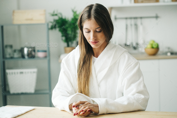 Woman on kitchen with mobile phone - Stock Photo - Images