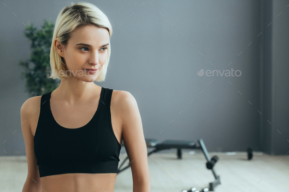 Sport. Woman in sport gym making exercise training. Sporty blonde female with sporty equipment. - Stock Photo - Images