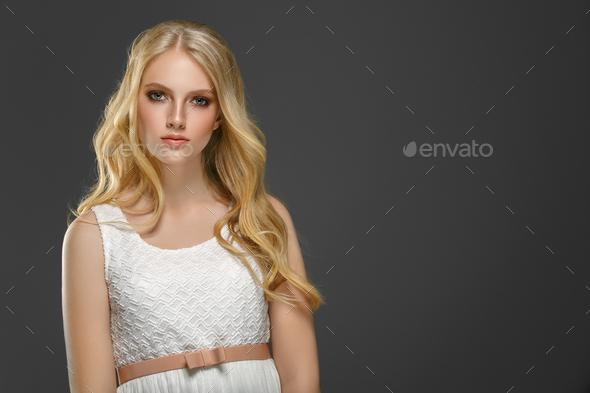 Curly long hair blonde young model. Beauty girl with curly perfect hairstyle - Stock Photo - Images