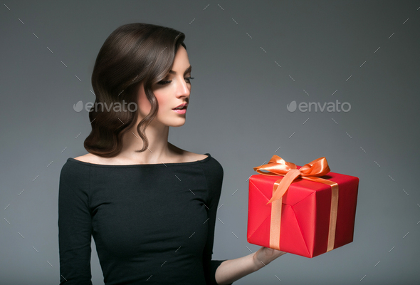 Woman with gift box - Stock Photo - Images
