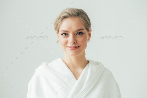 Woman in bath robe over white background, beautiful female with blonde hair beauty concept - Stock Photo - Images
