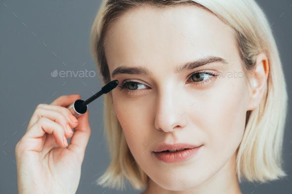 Woman mascara applying brush, female portrait makeup eyelashes. - Stock Photo - Images