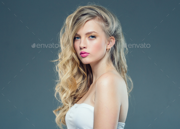Beautiful woman portrait with fresh daily make-up blonde curly hair and healthy skin - Stock Photo - Images