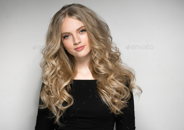 Blonde Woman Beautiful Portrait. Cosmetic concept, platinum Blond Curly Hair Model Girl. - Stock Photo - Images