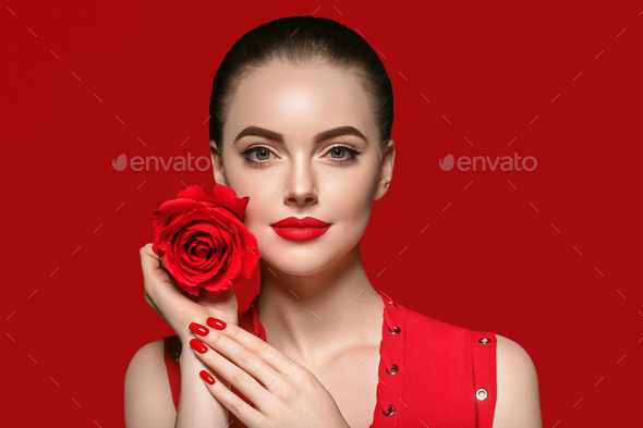 Woman with rose flower. Beauty female portrait with beautiful rose flower and salon hairstyle. - Stock Photo - Images