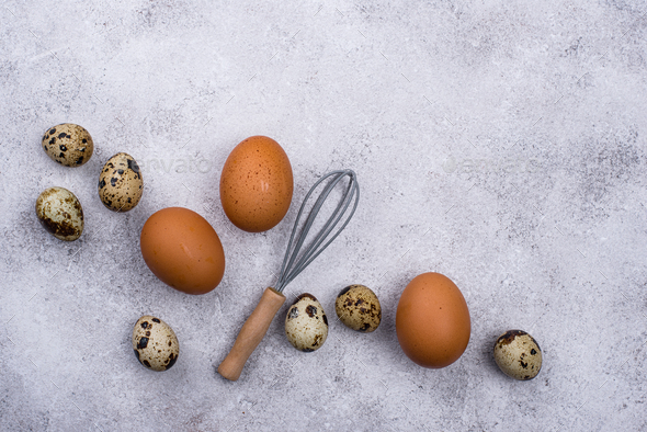 Chicken and quail eggs with whisk - Stock Photo - Images