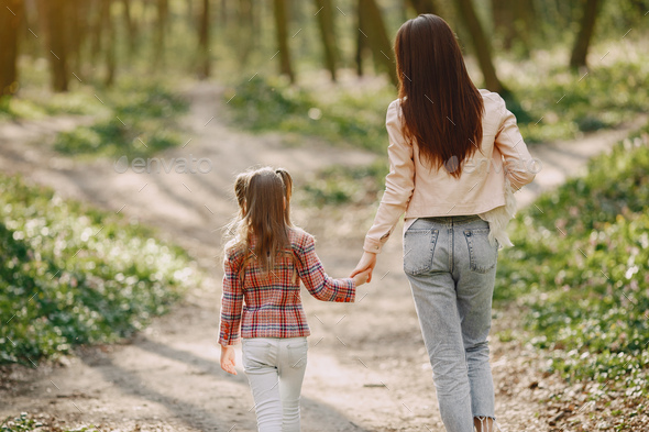 Elegant mother with daughter in a summer forest - Stock Photo - Images