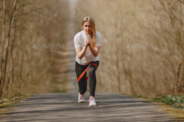 Sports girl training in a summer forest - Stock Photo - Images