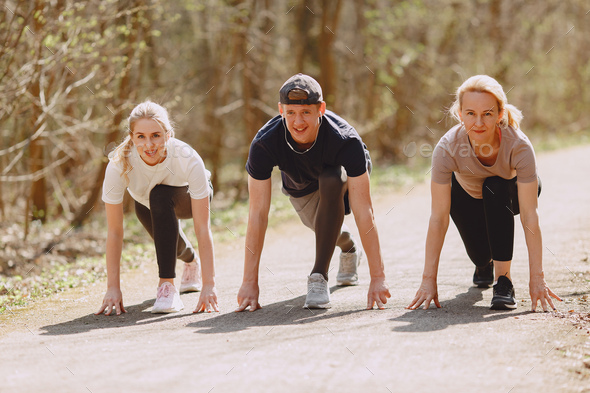 Sports family training in a summer forest - Stock Photo - Images