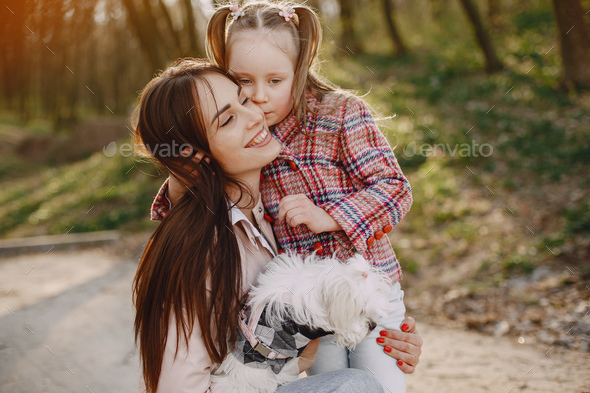 Mother with daughter in a spring forest with dog - Stock Photo - Images