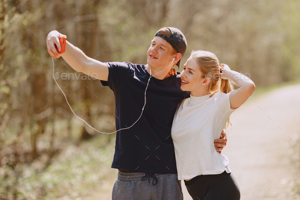 Sports couple training in a summer forest - Stock Photo - Images