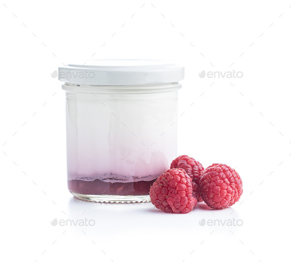 White fruity yogurt in jar an raspberries - Stock Photo - Images