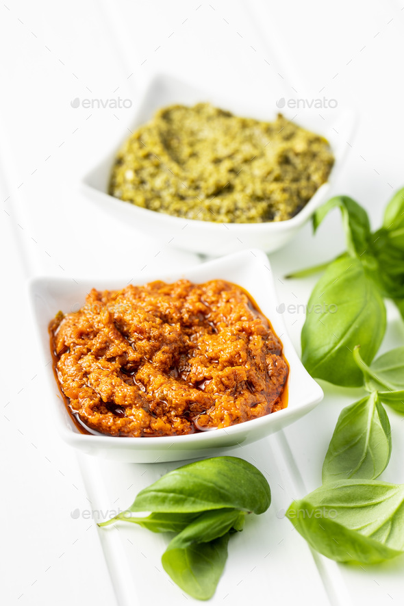 Green basil and red tomato pesto dip sauce  and basil leaves. - Stock Photo - Images