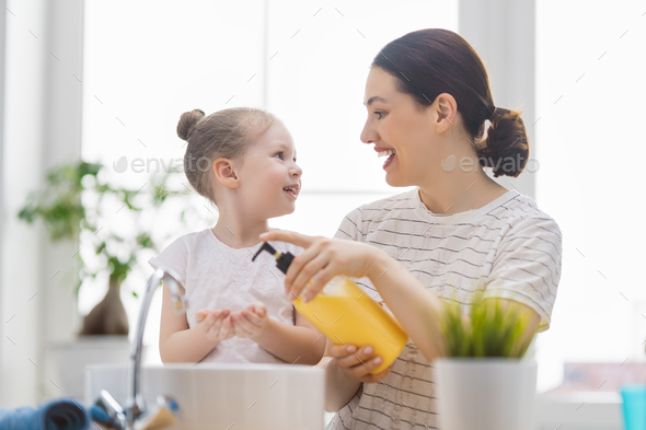 girl and her mother are washing hands - Stock Photo - Images