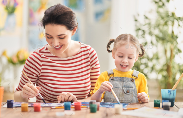 Happy family painting together. - Stock Photo - Images