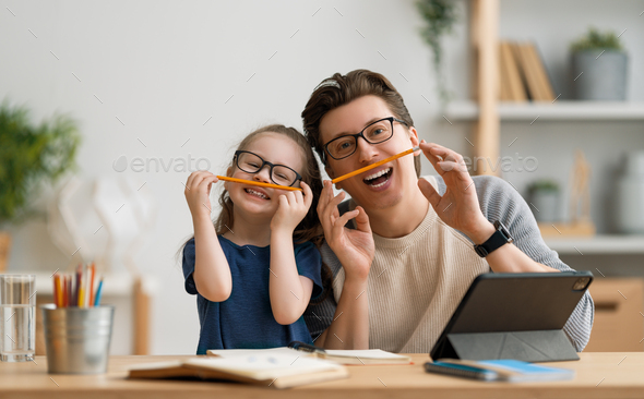 Girl doing homework or online education. - Stock Photo - Images