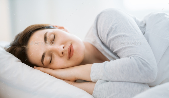 woman is sleeping in the bedroom - Stock Photo - Images