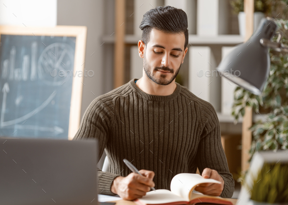 man working on a laptop at home. - Stock Photo - Images