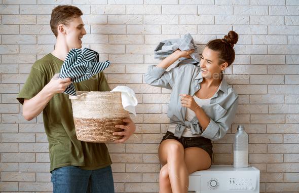 loving couple is doing laundry - Stock Photo - Images