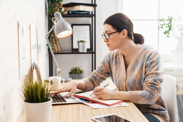 woman working on a laptop at home. - Stock Photo - Images