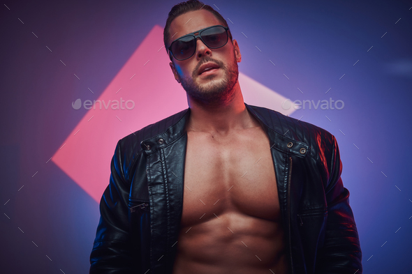 Portrait of handsome muscular man in the photo studio - Stock Photo - Images