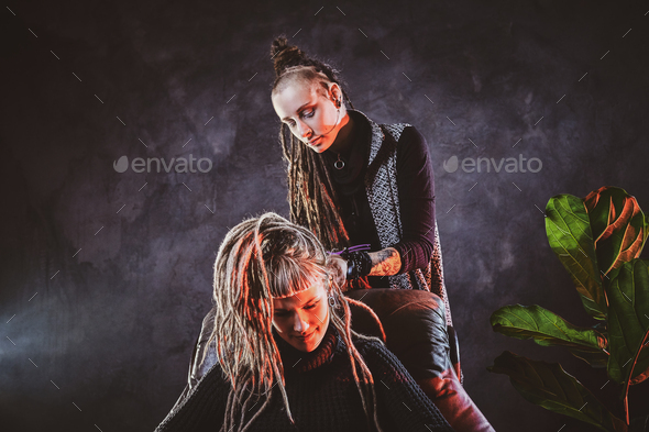 Talented master is making dreadlocks for a girl - Stock Photo - Images