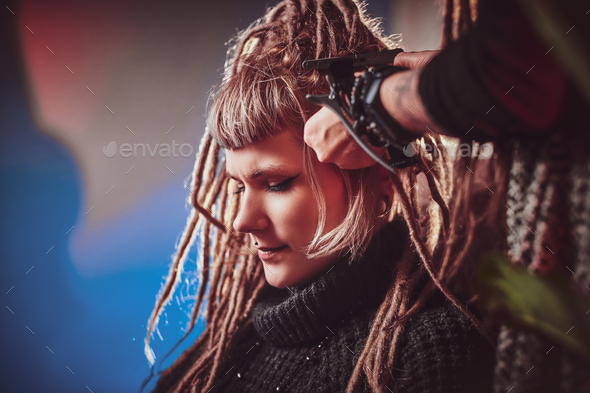 Dreadlocks master is working on client's head - Stock Photo - Images