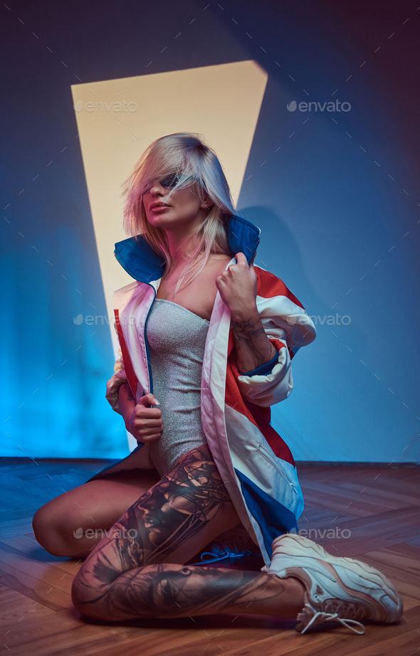 Portrait of beautiful model at photo studio - Stock Photo - Images