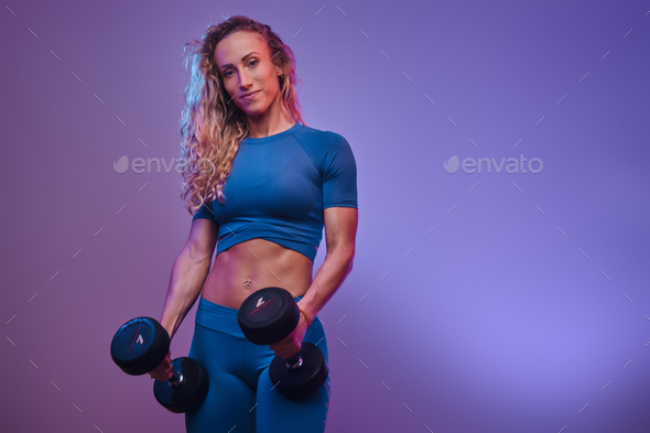 Portrait of a beautiful sporty woman - Stock Photo - Images